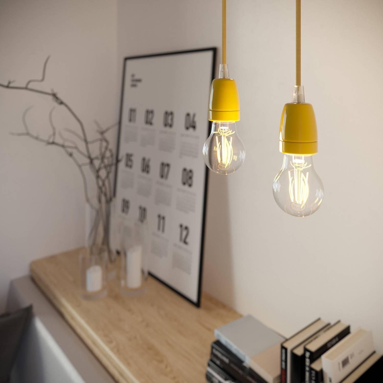 Lampada a sospensione Made in Italy completa di cavo tessile e finiture in porcellana colorata